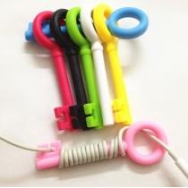 Lindo Cable Tie 5 psc Cord Clave Organizador abrigo del auricular de la devanadera (color al azar)
