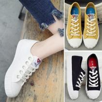 Zapatos de lona con cordones de tacón plano y punta redonda de estilo casual