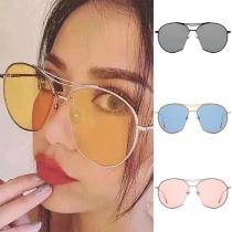 Modernas Gafas de Sol Unisex con Montura Redonda y Protección UVA