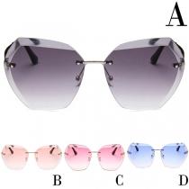 Gafas de sol sin marco y con forma irregular